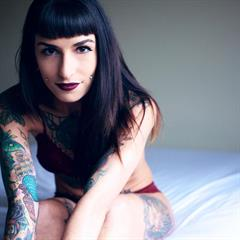 heavily tattooed suicidegirlsnow cheek piercings tattoo shaved album