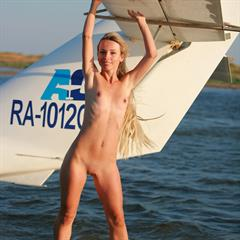 Natalia B outie belly button very long hair hydroplane headphones headphone by Rigin airplane tanlines