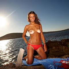 Jessie simonscans brunette tanlines busty beach rocks outside outdoor