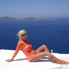 Zeta Theodoropoulou sunglasses pink nails kanonitv sea view red toes outdoor Greece tattoo shaved