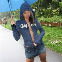 Ann Angel walking in the rain