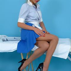 Rachel Louise pierced navel playboygirls blue eyes pinupwow costume British blonde nurse piercing