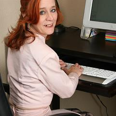 Maggie allover30 secretary computer redhead mature office chair desk
