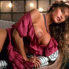 Cheryl Bachman white lingerie curly hair pink dress long playmate brunette big tits playboy vintage