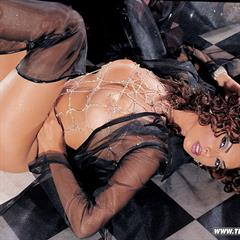 Tera Patrick black shoes curly hair stockings pornstar bracelet armchair pearls heels solo