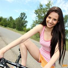 Vanessa Cyrus clubseventeen payserve barefoot brunette outdoor bicycle closeup shorts